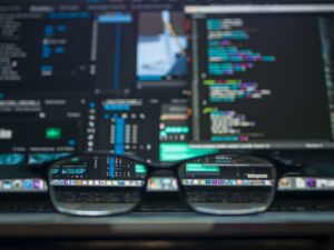Reading glasses sitting on table in front of a computer | Computer Network Set Up and Design | SkyViewTek